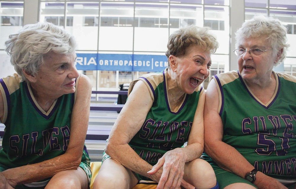 (From left to right) Fellow Silver Slammer teammates Jean Russo, 80 years old, Ann Lucas, 86 years old, and Jeanne Baker, 81 years old, laugh during the 2015 National Senior Games basketball competition. This competition took place on Jul. 14, 2015 at the University of St. Thomas Basketball Court in St. Paul, MN. Russo and Lucas are the oldest ones of the Silver Slammers and both hail from New Orleans. Baker hails from Connecticut.