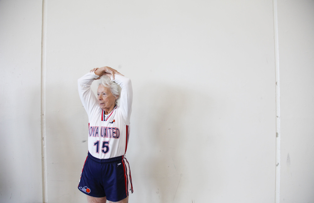 Judith Winston of the  NOVA United Classics stretches before her game during the National Senior Games basketball competition. This competition took place at the St. Thomas University Basketball Court in St. Paul, MN. on Jul. 9, 2015.