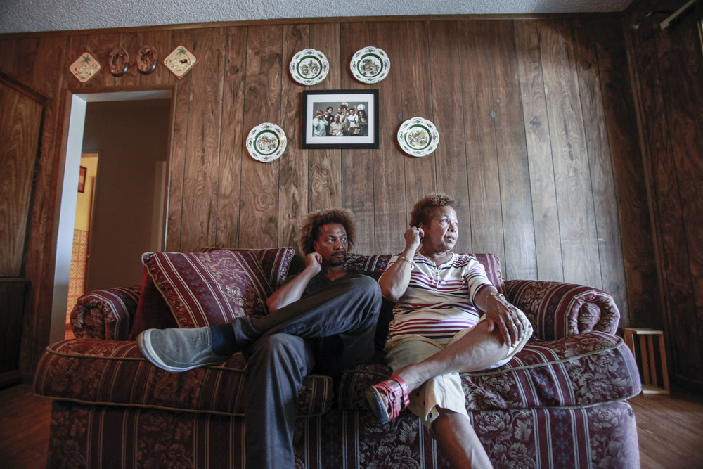 Dennis Mitchell (left) and Ella Mitchell (right) coincidentally use the same body movements while talking about old friends and family and plans for Anglee Mitchell, Dennis' father and Ella's husband, if something were to ever happen to him. This was photographed in Oxnard, Calif. on Oct. 5, 2015.