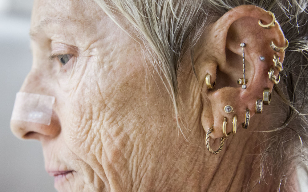Sue Ketterer shows off her piercings during the 2015 National Senior Games swim meet. This swim meet took place at the University of Minnesota's Aquatic Center on July 4th, 2015.