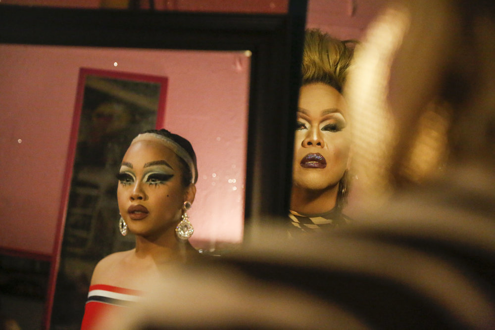 Lolita (left) and Marina Del Rey (right) both glance in the mirror before going onstage. Lolita, 22, is one of the youngest drag queens in the scene, while Marina has been performing for over a decade. Marina is the mother of the Del Rey family, which is one of the most prominent drag names in Hawai'i. Just recently, Lolita joined the Del Rey family and Marina became her mother.