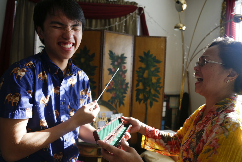 My younger brother, Manny (left) laughs with my mother, Erna Hobro (right), as he's given a baton for his 19th birthday. Manny is currently following in my mother's footsteps to become a music teacher. At the moment, he is an assistant band director at Wheeler Middle School. We were surrounded by music growing up and still are to this day.