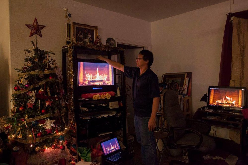 My father, Daniel Hobro, puts a YouTube video of a fireplace on multiple different devices to try and get the Christmas feel.