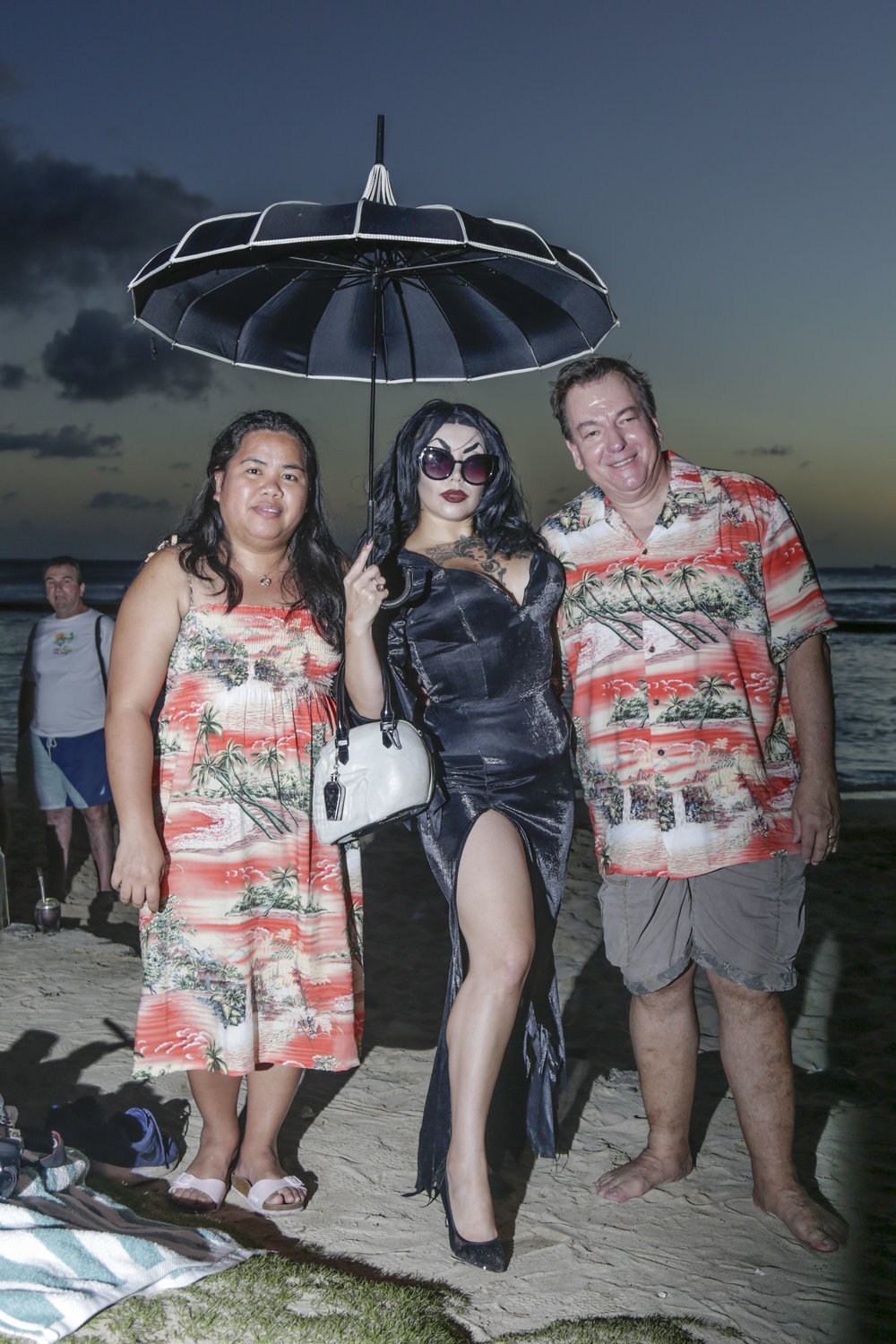 Tracy Lashes poses with tourists in Waikiki, HI. The tourism industry is a major contributor to Hawai'i's economy. According to the Hawai'i Tourism Authority, there are about 220,000 visitors per day in Hawai'i. On O'ahu alone, tourists spend about $19.9 million daily. This has made it difficult for Native Hawaiians to preserve their culture due to new developments constantly being built to meet the high demands of the tourism industry. Many culturally significant sights have been destroyed because of this.