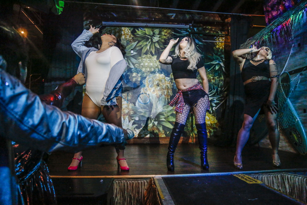 "The current cast of Diamonds of the Muff, (from left to right) Kalista Fox, Aria Del Rey and Lilith Satana, perform their ""Patron Tequila"" number at Scarlet Honolulu."