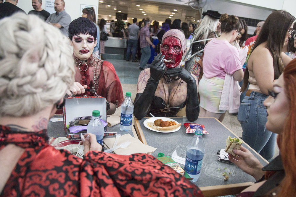 (From left to right) Dalia Black, Opulence Black, Victoria Elizabeth Black, and Waka.Shame of Black Haus eat lunch during RuPaul's DragCon LA at the Los Angeles Convention Center in Los Angeles, California on May 12, 2018. This three-day convention and festival, presented by RuPaul and World of Wonder Productions, returned for its fourth year at the Los Angeles Convention Center. It is the world's largest event celebrating drag culture. This year's DragCon featured over 90 drag performers-- the highest number that the convention has had in its four-year run.