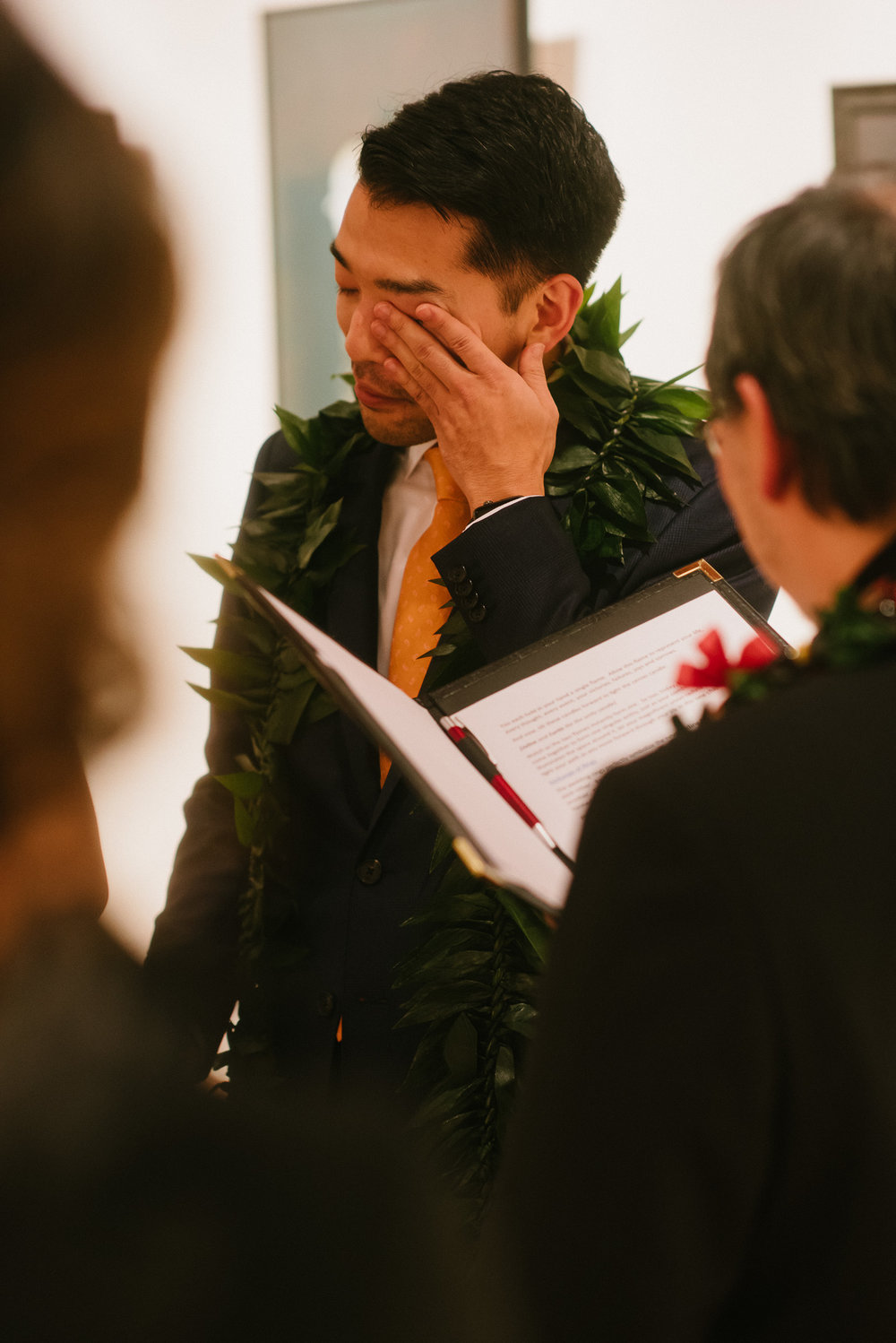 Groom Wiping Tears during Wedding Ceremony in Pioneer Square