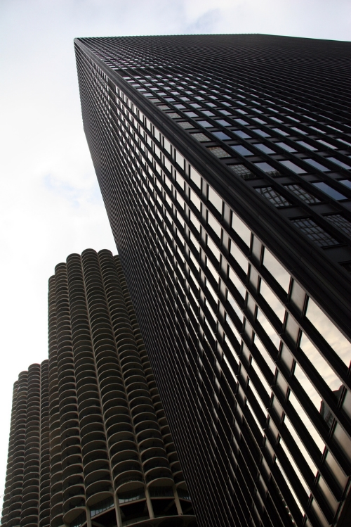 Mies van der Rohe - IBM Building next to the circular Marina Towers by Bertrand Goldberg