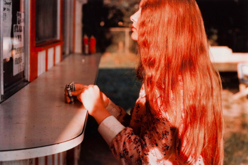 William Eggleston,   Untitled   (Girl with Red Hair, Biloxi, Mississippi), 1974