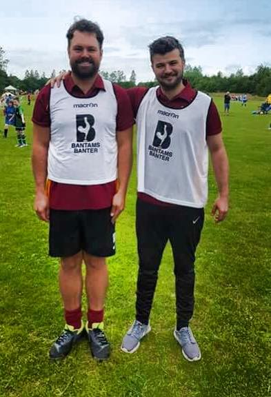 Tom and Dom wearing the brand new bibs that they raised money for us to be able to get as well as new equipment for training sessions.