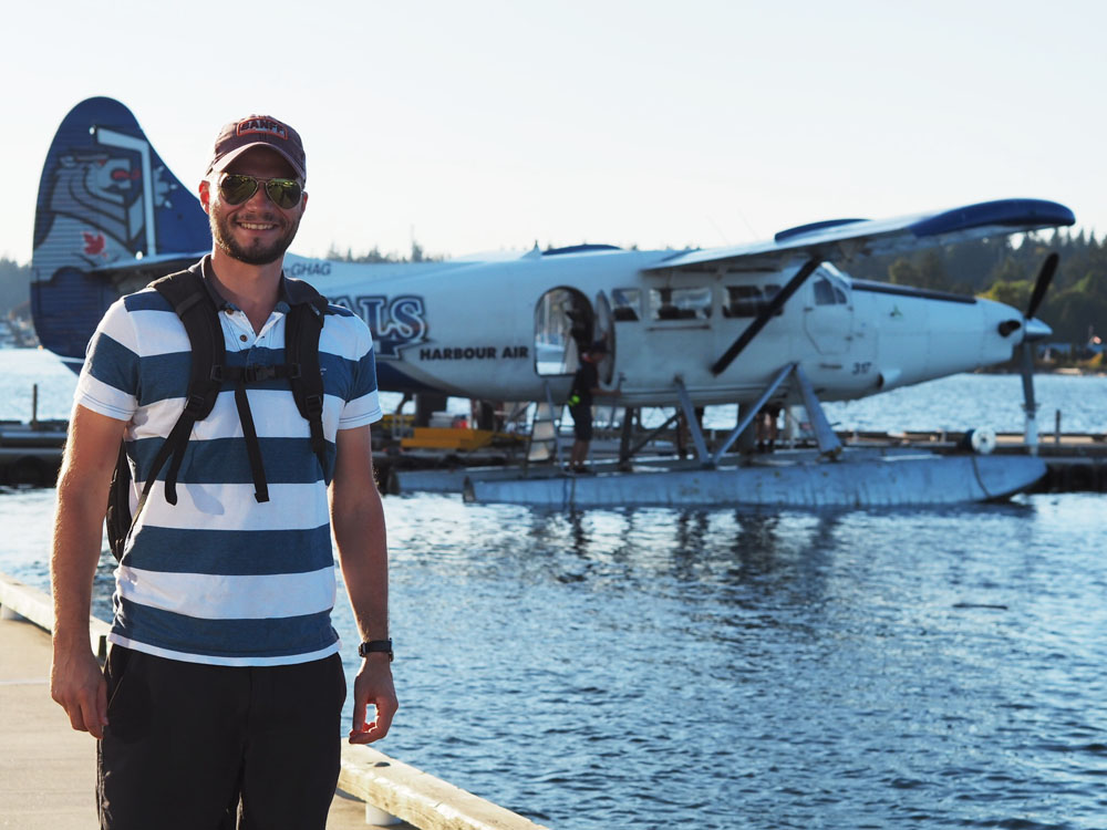 Happy Alex next to the Float Plane (he likes planes)