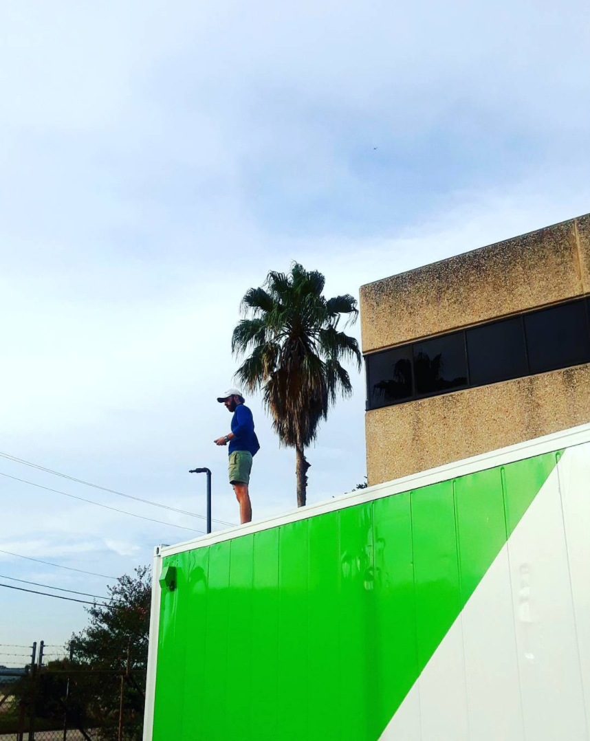 Andrew hanging out on top of one of the Acre in a Box LGMs in Houston, TX (Photo Credit AIAB Instagram).