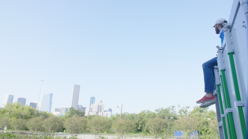 Andrew Enjoying the Houston Skyline from Farm