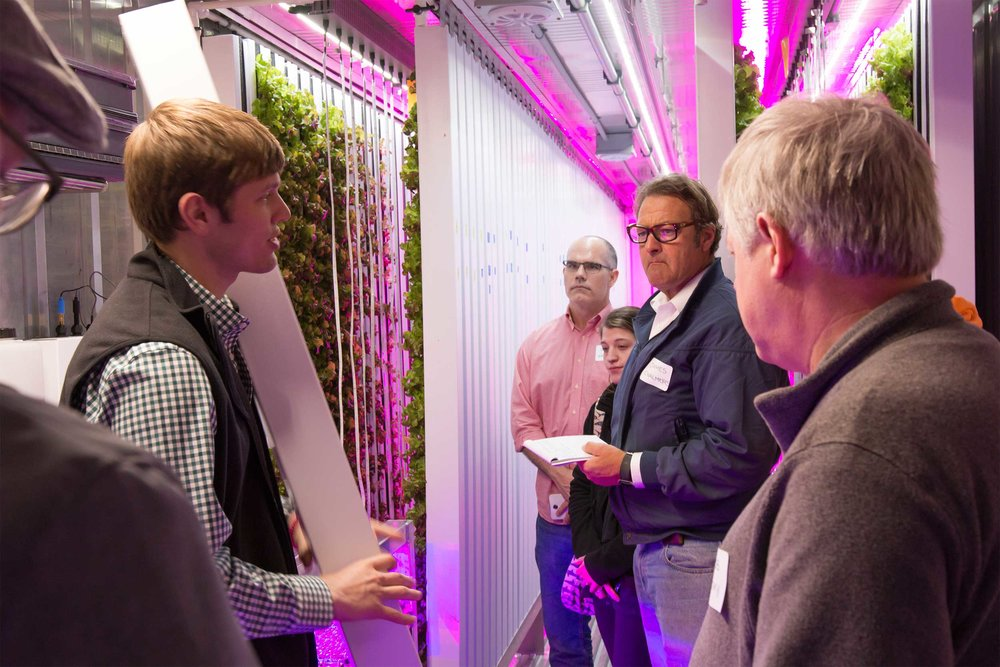 Andrew shows guests how lightweight the crop columns are! There are 256 in total, each capable of fitting 10-20 plants.
