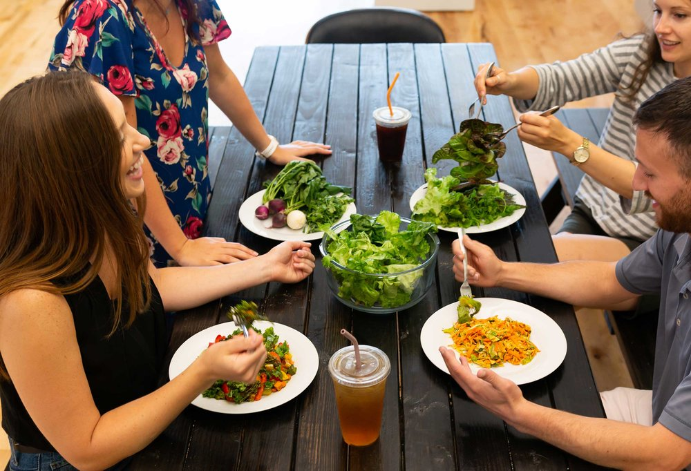 Employees enjoy a healthy lunch with Grown produce harvested from the office farm earlier in the day.