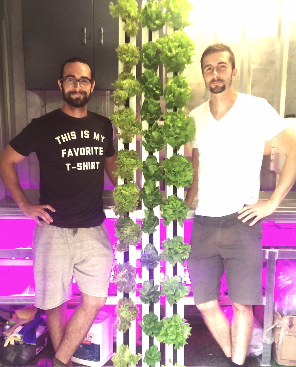 Travis (left) and David (right) with their first crops.