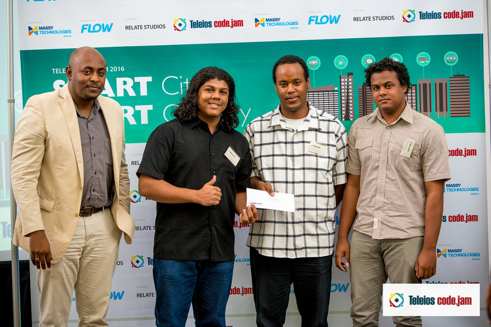 3rd place winners team tg  pose with their prize presented by learie roberts (Massy Technologies InfoCom)