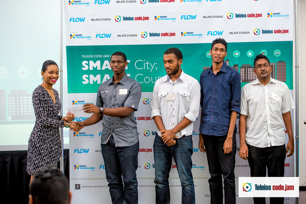 winners of the massy technologies infocom  prize for most innovative solution: team photon conservation society from uwi. receiving THEIR prize from nicola Marie Mc Clean.