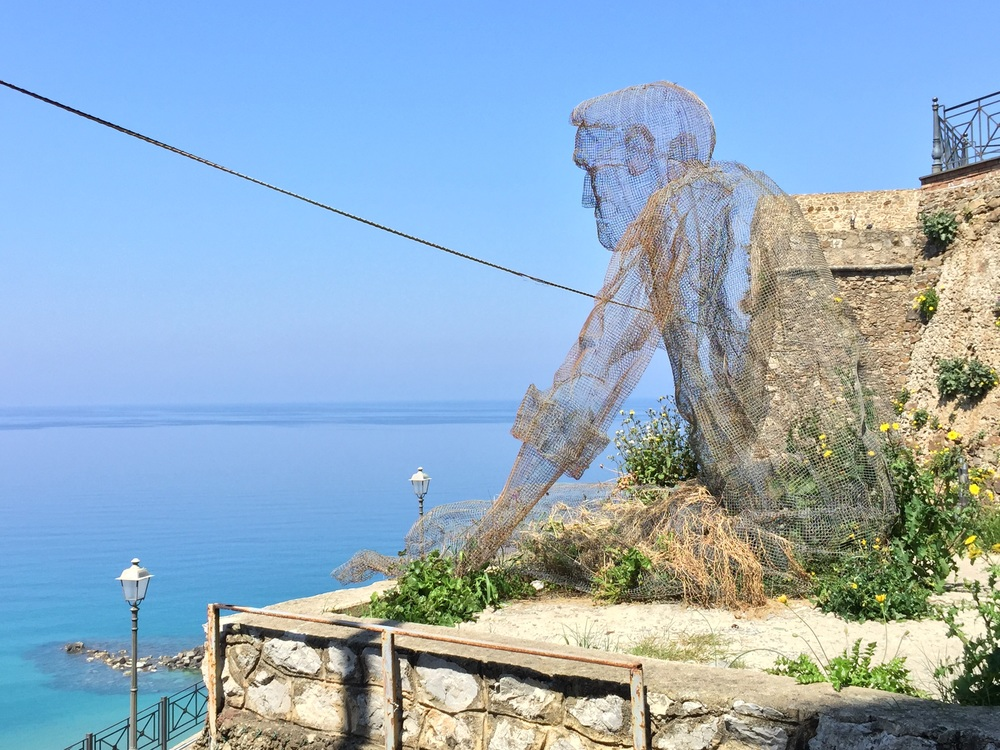 The old man and the sea, iron net statue by Eduardo Tresoldi, Pizzo.