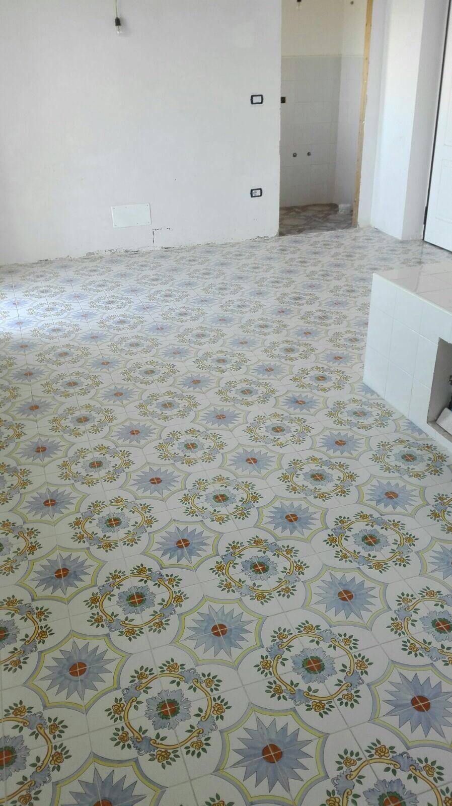 Dependance: kitchen not yet delivered but floor tiles look great!
