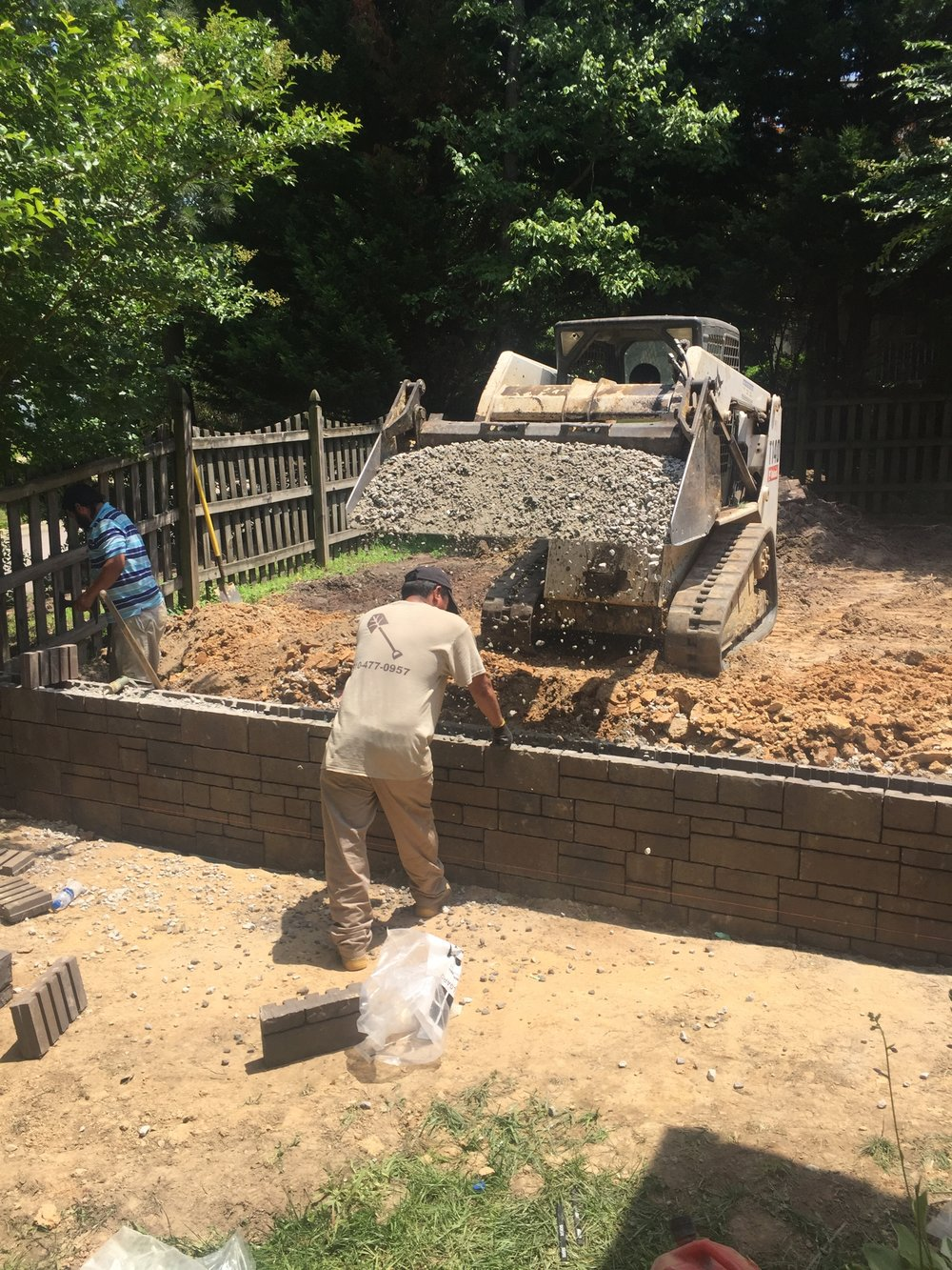 Backfilling Retaining wall with 57 Stone for Drainage