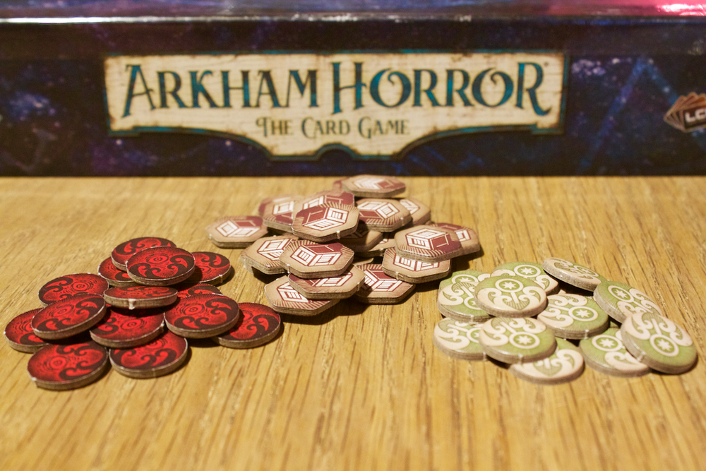 Doom tokens (left) and clues (right) are direct callbacks to the board game iteration