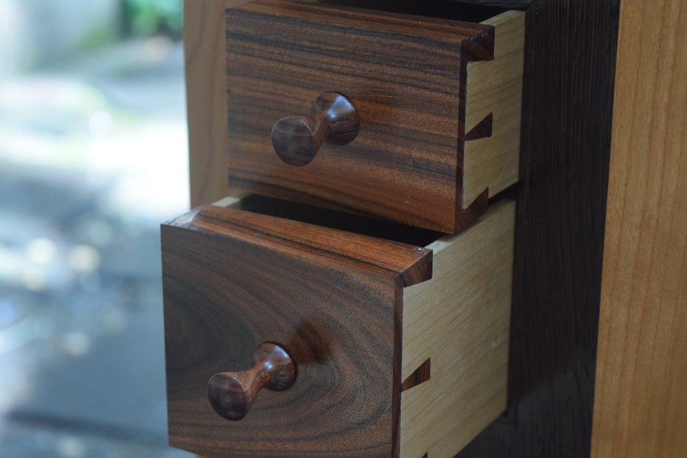 These small rosewood drawers are tucked into the side of a washstand.  Hand cut dovetails and turned pulls.