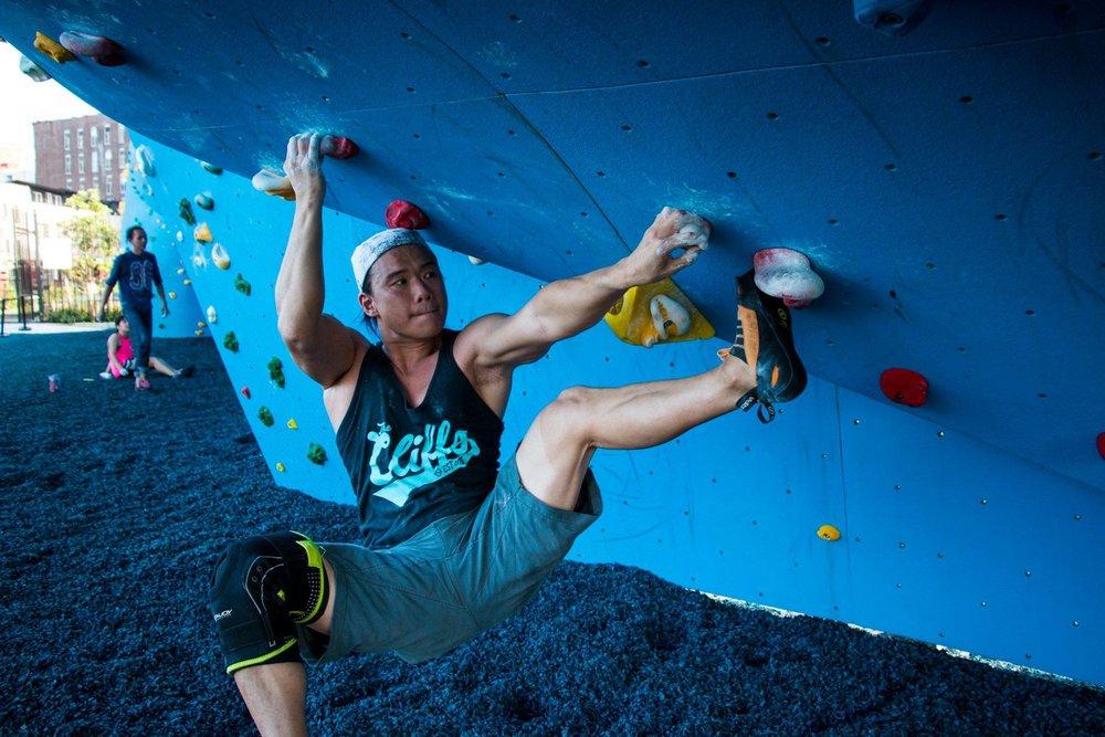 Member Peter flexing on the bulge at DUMBO Boulders.