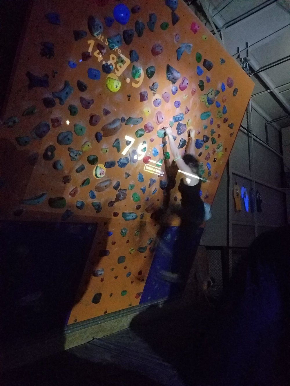 A new feature of the Halloween Blacklight Party: augmented reality bouldering!