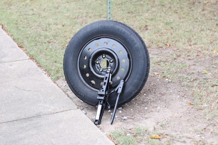 To change a flat, you will need a jack, tire iron, and spare tire. Photos by Braxton Maclean.