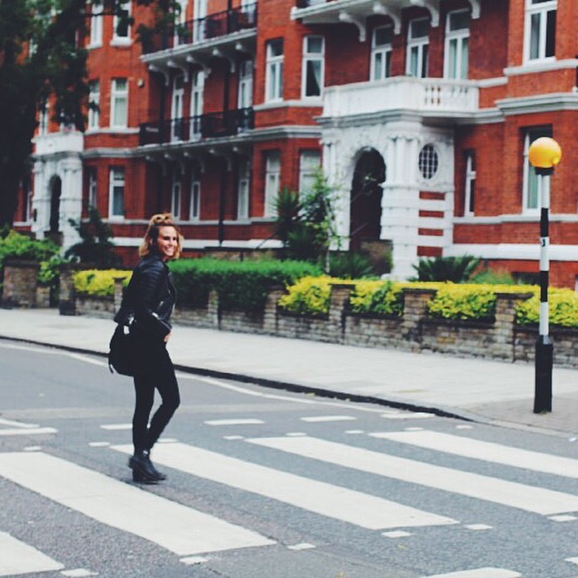 Walking across the famous Abbey Road Crosswalk