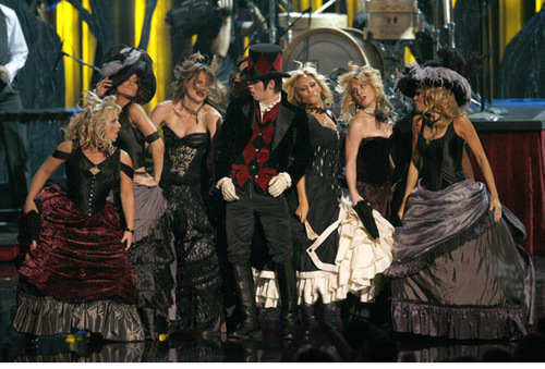 Dancing with Panic! At The Disco in 2006. Choreography by Danielle Flora (I'm all the way right in the big purple skirt and big hat.)