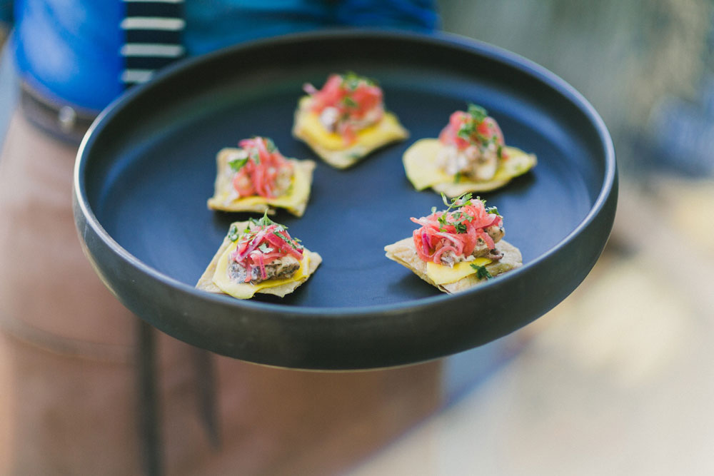 OCTOPUS TOSTADITA with sliced mango and pickled red onion