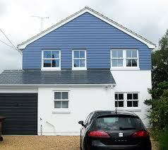 Weatherboard cladding and coloured render