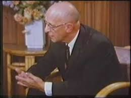 Film still of Carl Rogers in counseling session with Gloria