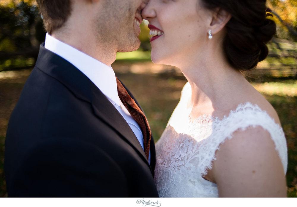 Cylburn Arboretum wedding photojournalism bride groom kisses smiles