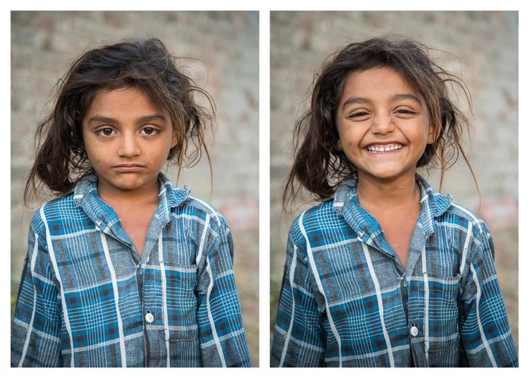 She was playing outside her home in the Village of Kakhsar, Gujarat, India...so I asked her to smile.