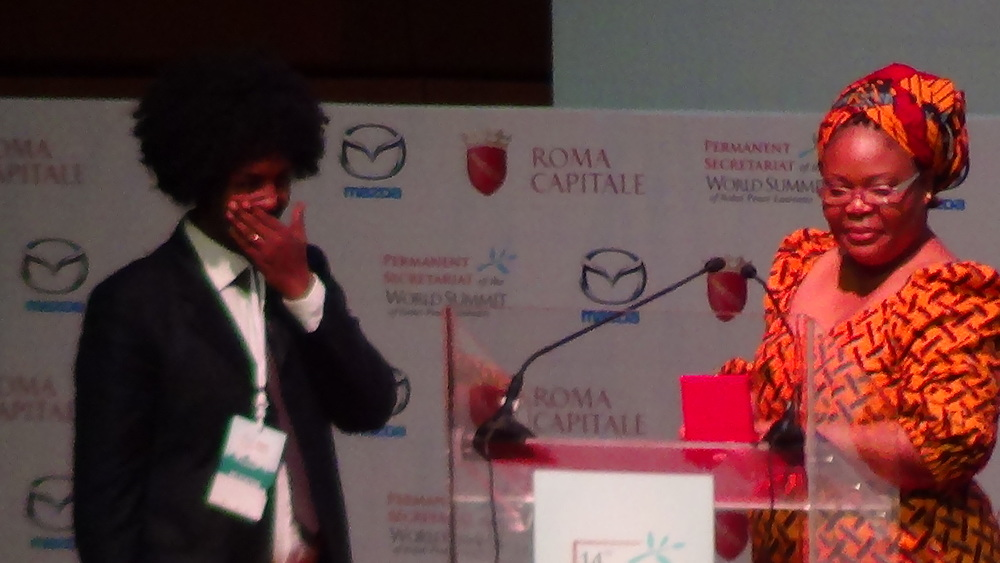 Tareke Brhane- recipient of Peace Summit Medal for Social Activism 2014 raising awareness on refugee issues in Italy.JPG