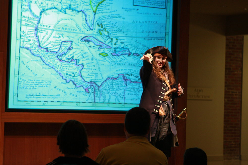 Anne Bonny, a female pirate in the 18th Century, engages the crowd.