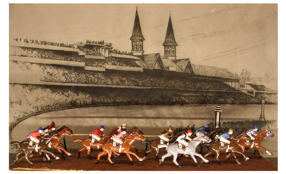 The Kentucky Derby diorama depicting the fastest 10 horses in Kentucky Derby history between 1930 and 1950,   11 horses featured  as 2 horses ran the same time.  M ade by Barclay Manufacturing Co. of New Jersey.  Painted in 1992 by Dr. William Schneider.