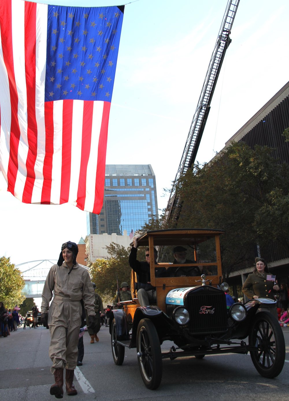 Frazier Teaching artists in Pearl Harbor Characters march down Main Street during Louisville's Veteran's Day Parade.