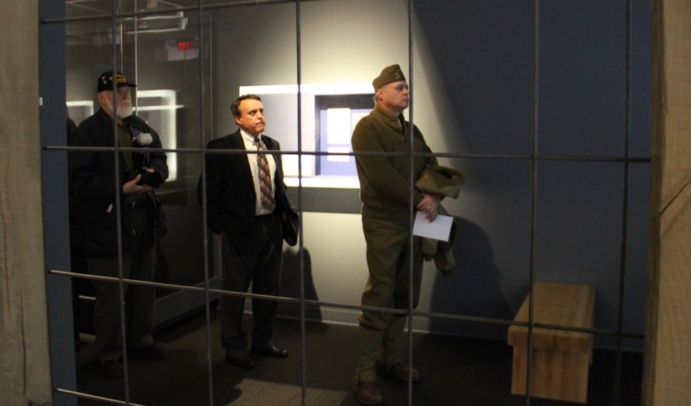 Visitors viewing the Personal Stories of Pearl Harbor exhibit.