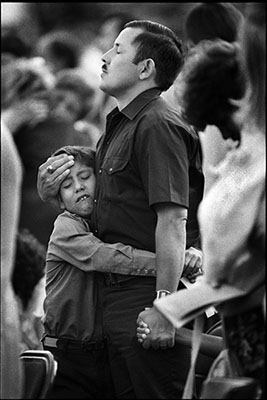 Father and son at a memorial service for the 27 people killed in the school bus accident near Carrolton, KY. ,1988. Photograph by Ben Van Hook..