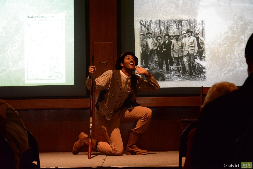 One of the Museum's historical interpreters performing for a group tour.