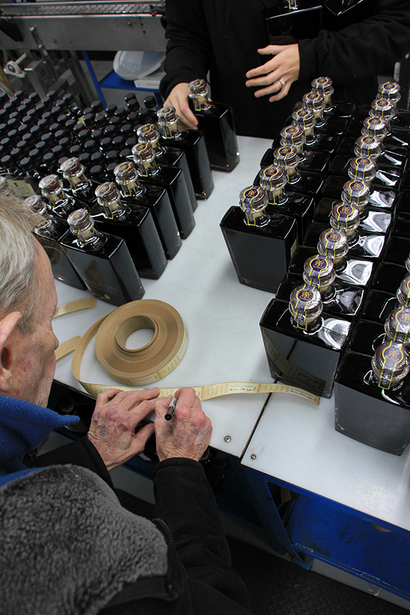 """James """"Buddy"""" Thompson preparing the labels for Final Reserve James Thompson & Brother, December 2017."""