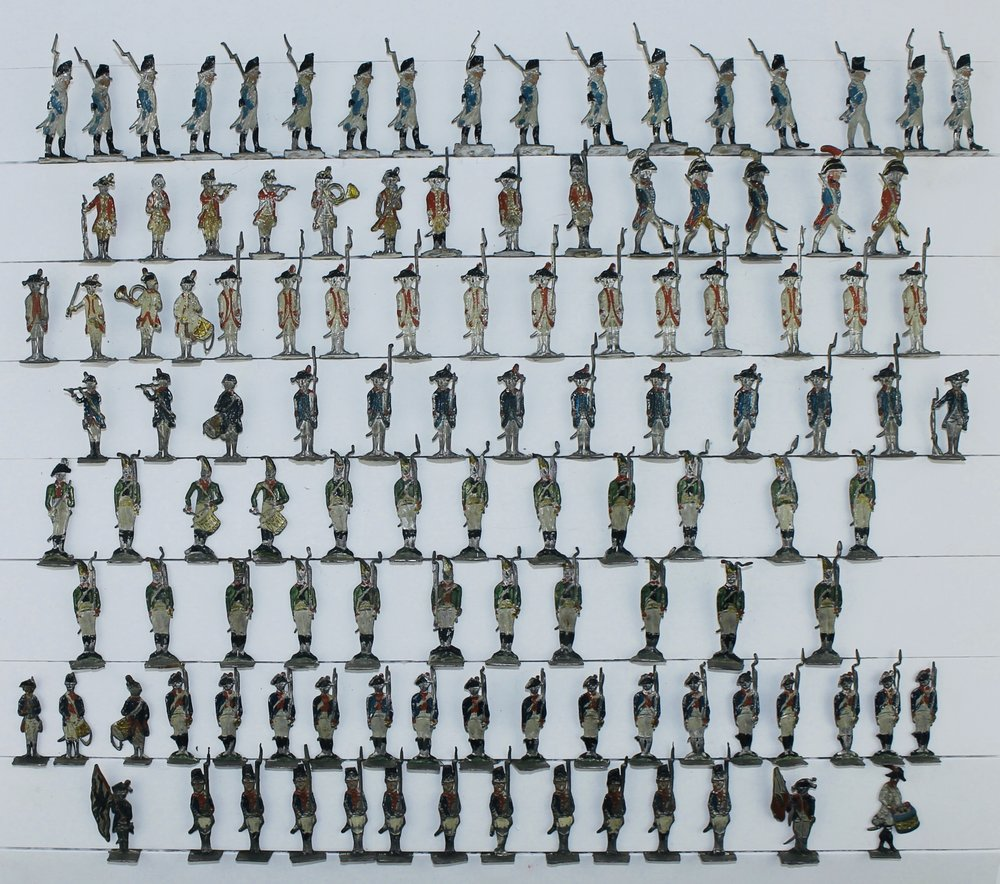 """Gerhardt Lezius, Germany, Infantry, c. 1765–85; Erik Lodin, Finland, French Troops, c. 1780s–1801. Rare tin flats, 30 mm. Formerly displayed in a shadow box titled """"Review of French Troops, ca. 1800."""""""