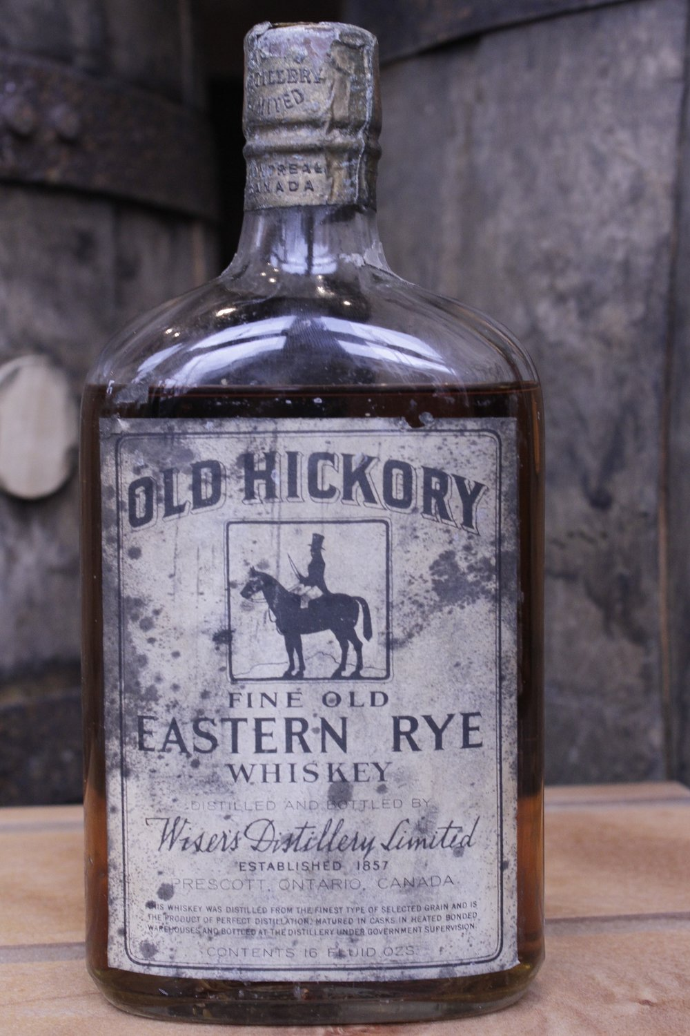 OLD HICKORY FINE OLD EASTERN RYE WHISKEY    About the Product   One pint of rye whiskey, bottled in bond. Distilled by Wiser's Distillery Limited, and bottled in 1925 by Wiser's Distiller Limited.  The product of perfect distillation, this whiskey was distilled from the finest type of selected grain, matured in casks in heated bonded warehouses, and bottled at the distillery under government supervision. The bottle's markings indicate that it was wax-dipped in Montreal and sealed in Ottawa.   About the Distillery   Wiser's Distillery Limited (1857 – 1924); Canadian Industrial Alcohol Co. (c. 1924). Prescott, Ontario, Canada.  Established in 1857 in Prescott, Ontario, JP Wiser's Distillery Limited was acquired by the Canadian Industrial Alcohol Company in 1924. This parent organization moved the distillery's operations to Corbyville, Ontario.
