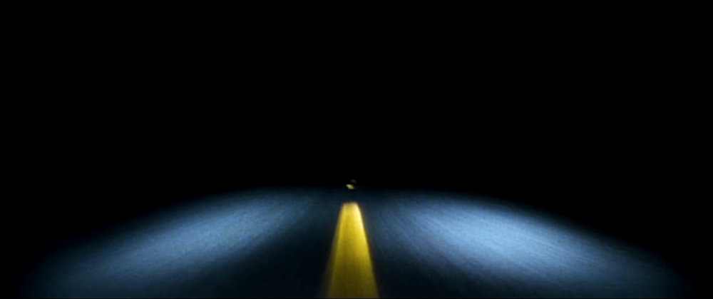 LOST HIGHWAY (1997)   After a bizarre encounter at a party, a jazz saxophonist is framed for the murder of his wife and sent to prison, where he inexplicably morphs into a young mechanic and begins leading a new life.