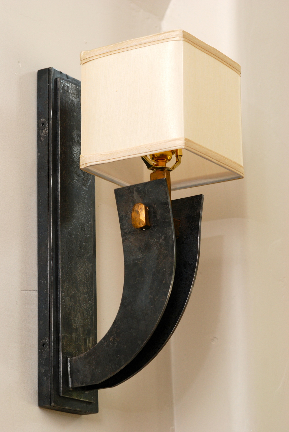 Steel and Bronze wall sconce