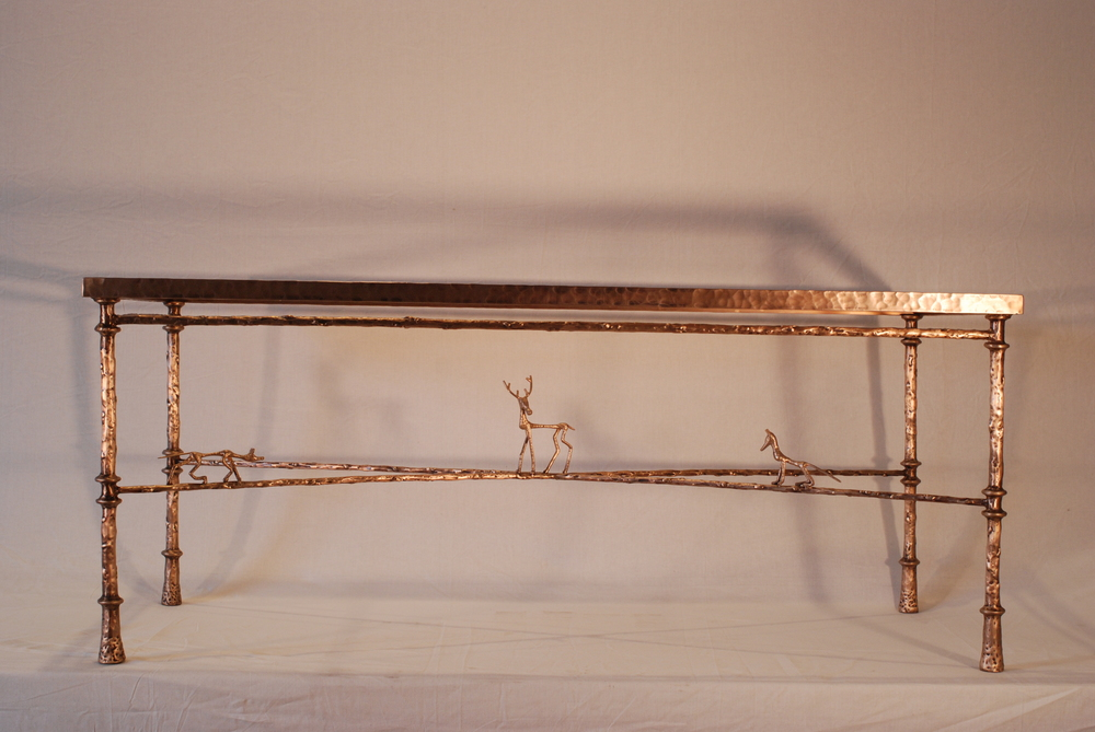 Giacometti inspired bronze coffee table with Stag